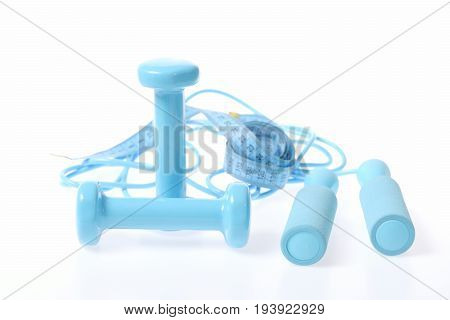 Skipping Rope And Cyan Dumbbells With Blue Measuring Tape