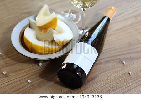 Aperitif, a glass of white wine and melon. White wine and melon.