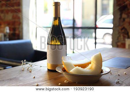 White wine and melon. Aperitif, a glass of white wine and melon.