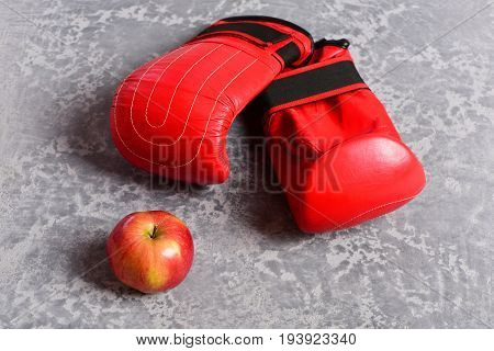 Sport Equipment And Fruit On Grey Texture Background. Boxing Gloves