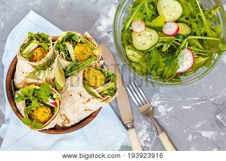 Vegan falafel wraps with salad and hummus. Love for a healthy vegan food concept.