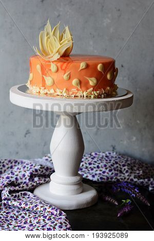 Carrot cake glazed with mirror glaze with carrot and orange filling