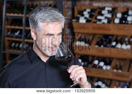 Red wine, tasting. Sommelier tasting red wine