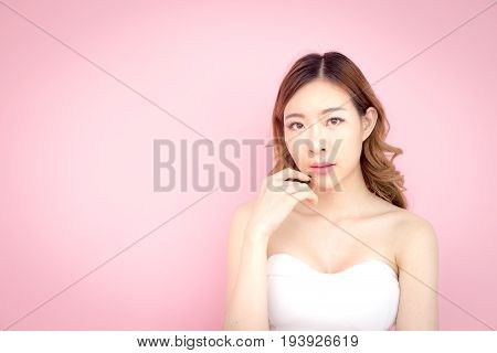 Beautiful Korea Woman Posing With Face And Skin Concept, Isolated On Pink Background, 20-30 Year Old