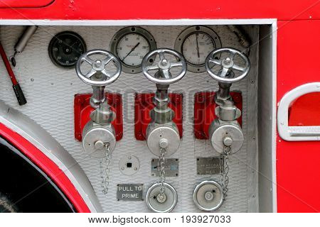 Beaulieu, Hampshire, Uk - May 29 2017: Fire Hose Connectors And Gauges On A Vintage Uk Fire Tender