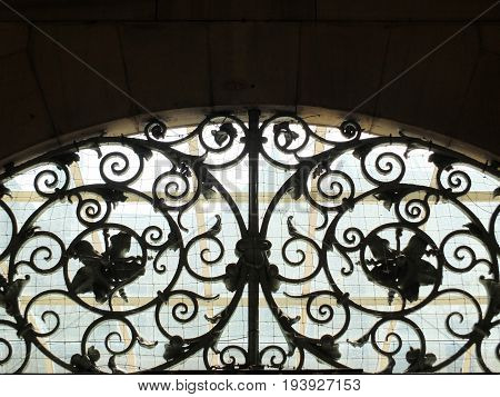decorative old spiral wrought iron work above a door