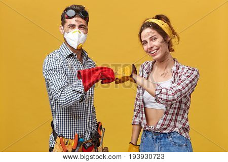 We Have Done It! Young Dirty Maintenance Workers Wearing Protective Gloves And Casual Clothes Keepin