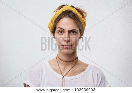Beautiful Female Showing Suspicion While Frowning Her Thin Eyebrows. Young Woman With Appealing Appe