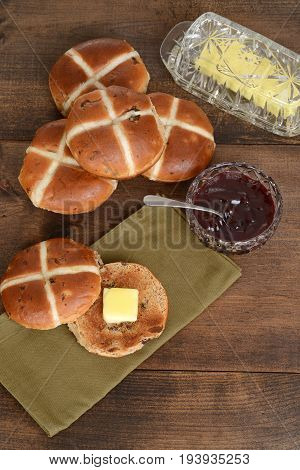 top view toasted hot cross bun with butter