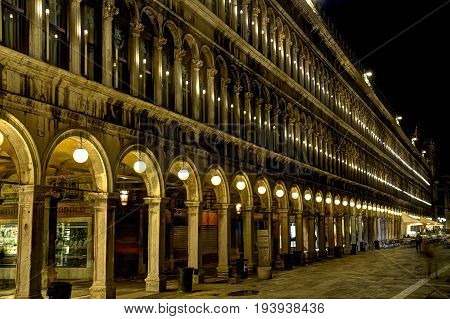 Detail of a building in Piazza San Marco in Venice at night.