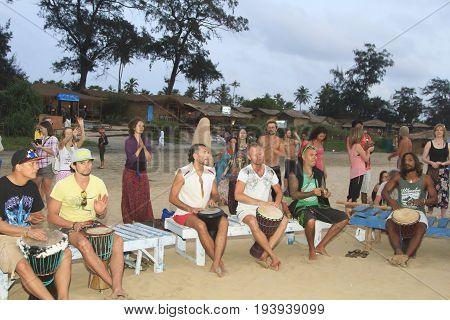 Goa India - February 28 2015: Unidentified man playing on drum at the beach. Goa state Arambol beach.
