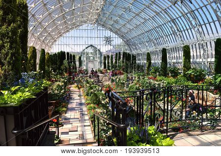 SAINT PAUL, MINNESOTA- JUNE 2017:  The summer flower show in the Sunken Garden at Como Zoo and Conservatory in St. Paul, MN.