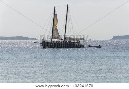 Villasimius Italy - September 28 2016: Boat with tourists on board approaches the coast