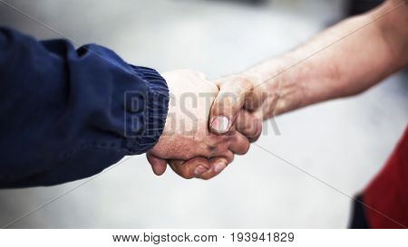 Handshaking Of Two Workers