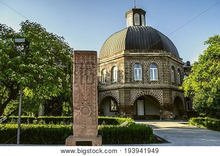 Ancient khachkar in front of the building of the Gevorkyan Theological Academy in Echmiadzin