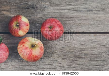 Red apples top view on rustic wood with copy space, fruit backround. Healthy food on table. Fall harvest, farming agricultural concept