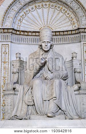 Rome, Vatican, Italy - July, 2, 2017: sculpture in St. Peter's Cathedral in Vatican, Rome, Italy is lighted by sunbeams