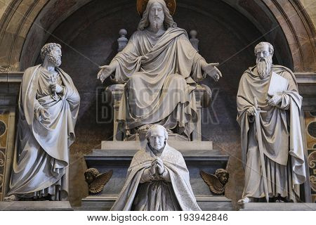 Rome, Vatican, Italy - July, 2, 2017: sculpture in the dark part of St. Peter's Cathedral in Vatican, Rome, Italy is lighted by sunbeams