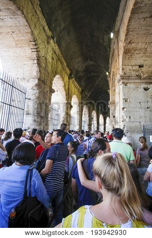 Roma, Italy - July, 2, 2017: line to the entrance of Colosseum, ancient Roman amphitheater, one of the main sights of Rome