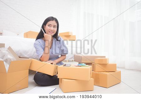 Young Asian Woman Business Owner Work And White Down Address For Deliver At Home, Woman Business Own