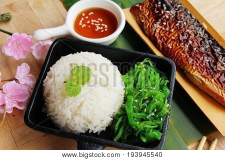 Saba fish rice with sauce and seaweed poster