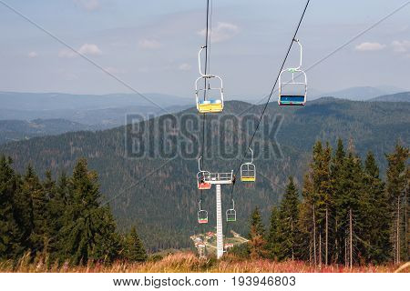 Mountain lift. Ropeway construction. Cabin moving on cableway, nature background
