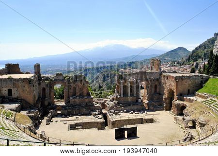 the Ancient Theatre of Taormina with Etna Mountain in background in Sicily Italy