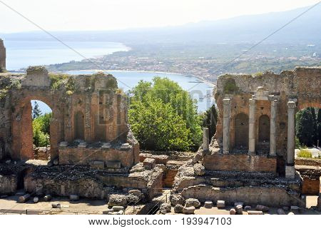 the Ancient Theatre of Taormina with Etna Mountain and mediterranean sea in background in Sicily Italy