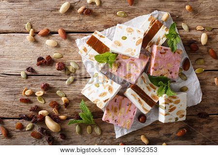 Sweet Nougat With Nuts, Decorated With Mint Closeup On The Table. Horizontal Top View