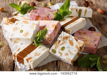 Delicious Nougat With Almonds And Pumpkin Seeds Close-up. Horizontal