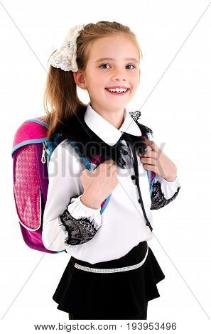 Portrait of smiling happy school girl child with backpack in uniform isolated on a white background