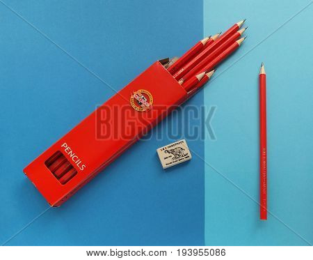 NACHOD, CZECH REPUBLIC - JUNE 29, 2016: Drawing pencils in box, one single pencil and eraser on blue papers, products of Koh-i-noor, the Czech manufacture, made in Ceske Budejovice