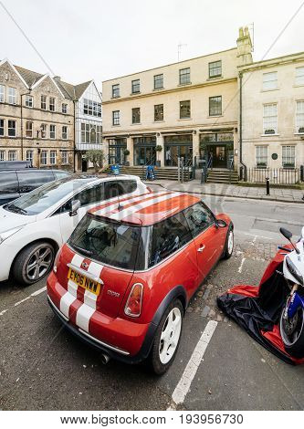 BATH UNITED KINGDOM - MAR 7 2017: Hall and Woodhouse Chic bar and British restaurant with a modern vintage vibe in 4 airy rooms with a roof terrace and red mini sport British car parked in front