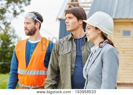 Building construction team standing proud at construction site