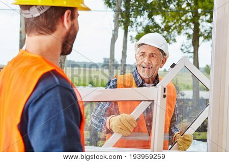 Window builder team working on woodhouse installation