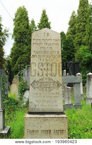 old decorated headstone on the jewish cemetery in Frydek-Mistek, Czech Republic, July 2, 2017