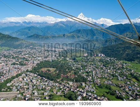 POKHARA, NEPAL. Flight on a hang glider (deltaplan). Shooting Pokhara and Green rice terraces of the Himalayas from the height of bird flight.
