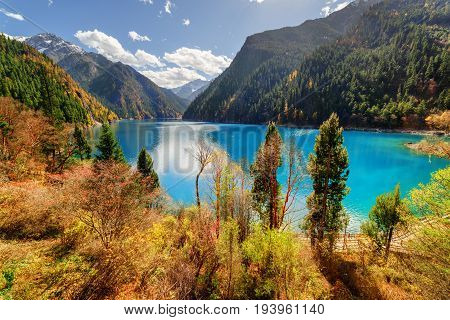 Fantastic View Of The Long Lake With Azure Water Among Mountains