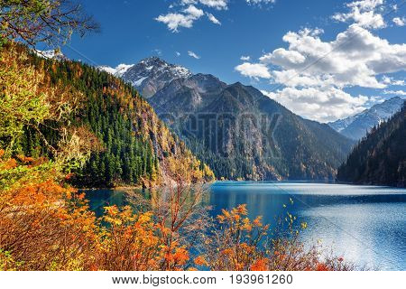 Fantastic View Of The Long Lake Among Mountains And Fall Woods