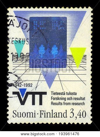 FINLAND - CIRCA 1992: a stamp printed in Finland shows symbolic depiction : triangles and grid, series technology, circa 1992