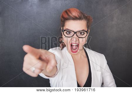 Angry Screaming Teacher Pointing Out On Chalkboard Background