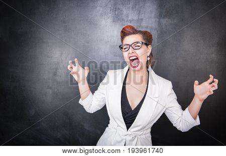 Crazy Screaming Teacher On Chalkboard Background