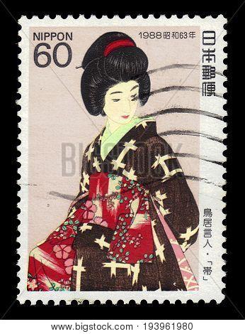 JAPAN - CIRCA 1988: A stamp printed in Japan shows japanese traditional dress Kimono Sash for women, series
