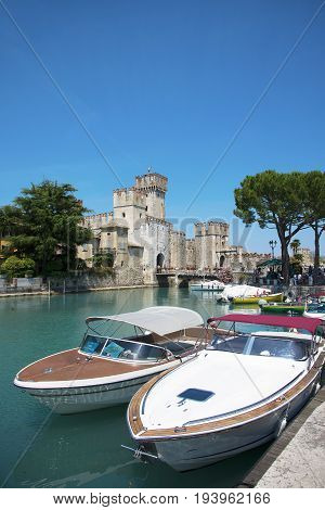 medieval castle Scaliger in old town of Sirmione . beautiful lake Lago di Garda Italy