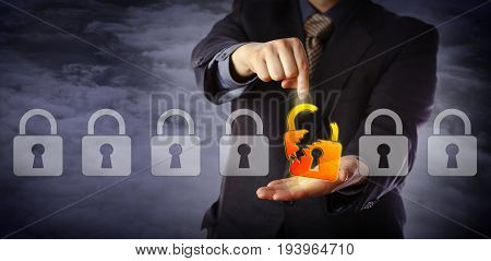Blue chip cyber security manager is pointing out a broken virtual padlock in a lineup of otherwise intact locks. Information technology concept for data security breach cyber risk and hacker attack.