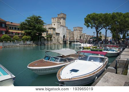 medieval castle Scaliger in old town of Sirmione . beautiful lake Lago di Garda Italy. June 19 2017