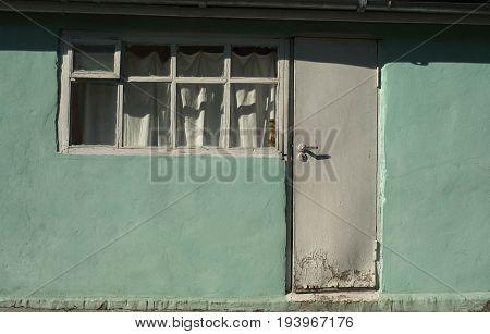 Door to the veranda of a house in the village