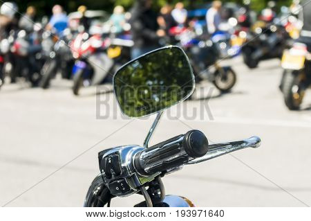 Detail on a motorcycle handlebar with mirror