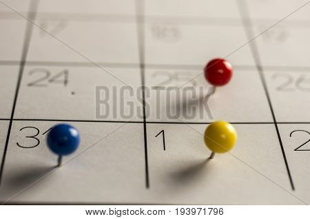 Close up shot of Christmas day New year's eve and day, marked with different color pins on calendar