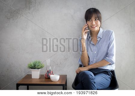 Asian Young Woman Using Smartphone At Coffee Shop With Happy Emotion, 20-30 Year Old.